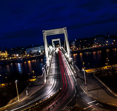 slanting (malark_) Tags: city longexposure nightphotography blue sky urban colors architecture nikon highway hungary traffic nikond70 budapest trail duna citylandscape danube 2012 18mm lighttrail bluecolor