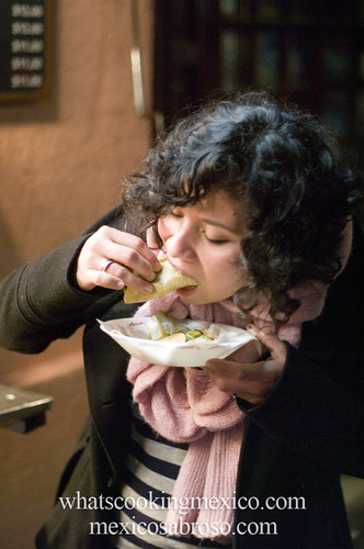 "Jeannete eating tacos<br /><span style=""font-size:0.8em;"">Read more about it here: <a href=""http://whatscookingmexico.com/2012/02/13/the-anatomy-of-a-taco/"" rel=""nofollow"">whatscookingmexico.com/2012/02/13/the-anatomy-of-a-taco/</a></span> • <a style=""font-size:0.8em;"" href=""https://www.flickr.com/photos/7515640@N06/6862929729/"" target=""_blank"">View on Flickr</a>"