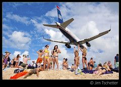 One more from Maho.... (IC360) Tags: girls beach airplane sand aviation landing sunsetbeach stmaarten bikinis usair mahobeach airportbeach stmaartenairport ic360images princessjulianairport jimtschetter