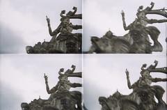 fading away (nuo2x2toycam) Tags: bali statue stone indonesia four god kodak 200 hindu quadruple ubud toycam wayang dewa colorplus disderi nuo2x2 nuo2x2toycam