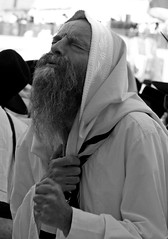 """O God of my praise, keep not silence;"" (ybiberman) Tags: portrait bw man israel jerusalem prayer pray fist devotion westernwall talit wailingwall"