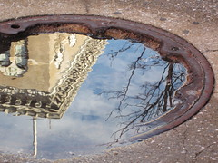 sidewalk mirror  (1 of 3) (Zombie37) Tags: street city blue winter sky urban reflection building tree wet water pool rain metal clouds corner mirror waves view angle upsidedown distorted branches details gray cement arc shapes rusty surface baltimore sidewalk edge ledge round after chance ripples manhole curve shape curved pooled wavy circular mtvernon rainwater surprising 2012bestmaybe
