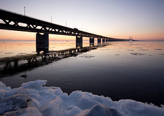 transportation (Andreas Hagman) Tags: bridge blue sunset sky sun seascape ice water birds truck copenhagen purple sweden tripod calm lorry scandinavia malm floe windturbines uwa resundsbron sigma1020mm calmsea sonyalpha groundedboat slta77 ginordicfeb12