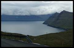 Panorama between Eysturoy and Kalsoy (little_frank) Tags: ocean road travel sea wild panorama cliff mountain travelling green nature beautiful beauty rock wonderful landscape bay coast amazing scenery solitude alone loneliness peace view place natural cloudy exploring horizon hill north dramatic rocky surreal peaceful tranquility atlantic erosion adventure formation mount silence sound stunning land fjord lonely nordic rough geology wilderness guardrail northern barren faroeislands breathtaking impressive admiring archipelago vastness waterscape marvellous unspoiled faroer immensity froyar geologic frerne eysturoy faeroerne foroyar kalsoy seabord frer