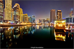 Marina Reflections #3 (Najib Nasreddine) Tags: city red sea sky color reflection building water yellow architecture night digital marina catchycolors landscape photography boat high lowlight nikon colorful long exposure dubai cityscape shot dynamic angle yacht low uae wide middleeast east processing imaging middle nikkor range unitedarabemirates hdr skyscaper highiso yachtclub najib   catchycolorsyellow        nasreddine 1024mm d7000