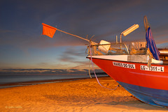Mares do Sul (Quim Castilla) Tags: sunset praia beach portugal boat barca playa loveit photomix salema greatphotographers topshots worldwidelandscapes natureandpeopleinnature theoriginalgoldseal mygearandme eltringexcellence magicmomentsinyourlife magicmomentsinyourlifelevel2 soulocreativity4 rememberthatmomentlevel6 vigilantphotographersunite vpu2 vpu3 vpu4 vpu5 vpu6