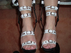 Front View of Feet Buckled in Heels, Suspended (KAFOmaker) Tags: whiteandblack brace braces braced bracing legbrace legbraces legbraced legbracing high heel highheels heels strap straps strapped strapping cuff cuffs cuffed cuffing ankle ankles anklestrap anklestraps buckle buckles buckled buckling bondage fetish sexy leather spread spreader spreaders bound restrain restraints restrained restraining shoes sandal sandals orthopedic orthopedics appliance rivet riveted kafo
