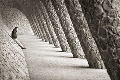 Where The Soul Can Rest (Ben Heine) Tags: parcgell spain barcelona soul benheine photography art composition columns gaudi vanishingpoint sepia silhouette architecture unusual special twisted gravity man loneliness solitude concern wherethesoulcanrest antonigaudi depth perspective shadows light illumination patience question balance equilibre fulfillment wait rhythm chemin destiny fate monochrome symmetry geometry ame afterdeath afterlife lines simplicity arch arche colonnes texture wall mur human homme mood atmosphere ambiance quite peaceful peace pace barcelone espagne parc