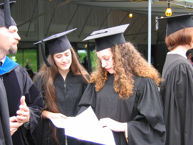 Graduates Looking at the Program as John Sheehy Looks On
