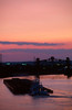 Going Home (John Cothron) Tags: sunset summer sky cloud sun color film nature water creek 35mm canon river landscape boat twilight stream industrial cityscape outdoor dusk kentucky louisville tugboat flowing barge ohioriver eos3 freshwater fujivelvia50 jeffersoncounty rvp50 canonef3580mmf456 johncothron cothronphotography shippingportisland