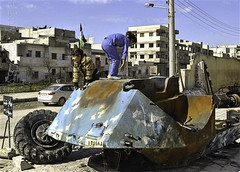 Syrian girls play on top of a destroyed Syrian...