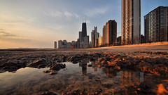 Sunrise at the Lakefront (Explored!) (Seth Oliver Photographic Art) Tags: chicago sunrise buildings reflections landscapes iso200 illinois nikon midwest cities cityscapes lakemichigan navypier pinoy johnhancockbuilding urbanscapes secondcity windycity chicagoist chicagolakefront goldcoastneighborhood d90 puddlereflections wetreflections lakepointetower tonemapped cityofbigshoulders 16x9crop sunriseshots aperturef80 perfectsunsetssunrisesandskys manualmodeexposure setholiver1 circularpolarizers timedelaytriggeredshot 1125secondexposure