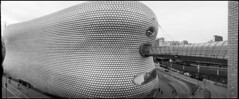 Cyclops (*monz*) Tags: road bridge people blackandwhite bw panorama building cars film church st wall architecture lens 1 birmingham bricks pedestrian panoramic swing 150 selfridges widelux push hp5 rodinal martins ilford f28 brum 20c f7 26mm monz panon 1stop 165mins autaut
