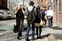 blonde on a cell phone (omoo) Tags: newyorkcity westvillage cellphone streetscene sidewalk wigstock blonde greenwichvillage bleeckerstreet neverends platinumblonde blondewithacellphone manwearingblondewig