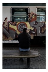 waiting in vain (carpe shot) Tags: street italy station train dark graffiti florence loneliness darkness streetphotography trainstation tuscany firenze cigarettes