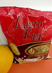 Lacto Fun (cowyeow) Tags: china strange fun hongkong weird milk office funny candy odd packaging sweets snacks lactate causewaybay funnysign lacto funnychina funnyhongkong