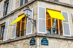Rue Poulbot Windows (Serendigity) Tags: city paris france window yellow awning streetsign montmartre shutters