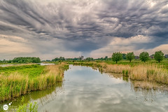 In the sky (Robert Stienstra Photography) Tags: cloud reflection nature weather clouds reflections skyscape landscape landscapes outdoor wageningen cloudscape cloudscapes waterscape gelderland naturalforces waterscapes landschappen cloudformations landscapephotography skyporn geldersestreken