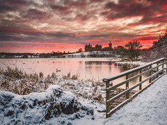 Fire and Ice (buddsnax) Tags: uk ice sunrise scotland swan ruins swans loch historicscotland linlithgow linlithgowpalace westlothian