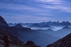 Dolomiti 1979 (karlbauernhansl) Tags: dolomiten dolomites dolomiti mounains berge gebirge layers schichten fog nebel mist wolken clouds sky rocks felsen italy italien southtyrol 1979