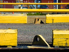 Yellow Rails (Steve Taylor (Photography)) Tags: wood newzealand orange texture car yellow metal wooden belt factory timber rail nelson tex machinery nz southisland guide conveyor