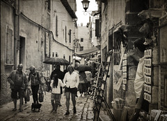 Rovinj Old Town, Croatia (Nikos Niotis) Tags: street old summer people blackandwhite texture tourism rain architecture buildings outside town europe outdoor croatia area shops venetian streetphoto balkans blacknwhite umbrellas oldtown rovinj bnw touristic croatian istria summerrain
