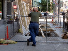 Is he lost in thought or just killing time? (kennethkonica) Tags: old city people usa america canon fence lost midwest random outdoor candid indianapolis indy indiana jeans mature persons bluejeans moods urba global hoosiers canonpowershot marioncounty seniorcitizen