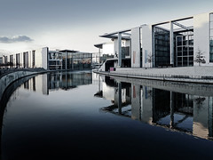 Government District Blues (parkerbernd) Tags: blue reflection berlin architecture river germany lumix district blues architektur government spree tones mitte spiegelung paullbehaus regierungsviertel axelschultes marieelisabethldershaus stephanbraunfels banddesbundes charlottefrank lx3