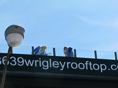 Getting the rooftops ready (debstromquist) Tags: chicago illinois spring rooftops il wrigleyfield lakeview chicagocubs openingday wrigleyville happynewyear cubsopener 3639wrigleyrooftopcom