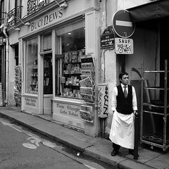 Waiter having a break (vieweronline) Tags: street people blackandwhite paris france monochrome break noiretblanc streetphotography candids stgermain waiter g12 candidshots havingabreak photosderue bucinews canong12