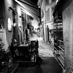 Cannes (Peter Gutierrez) Tags: street old city light shadow people urban bw white black france streets history 6x6 film public architecture night zeiss dark square french evening noche la town photo ancient europe riviera european nocturnal time nacht cannes pavement ikoflex cte architectural historic sidewalk peter nighttime gutierrez ikon nuit nocturne notte franais canas ancienne alpesmaritimes franaise peter historiques dazur gutierrez