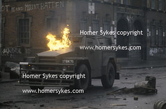 PETROL BOMB EXPLODING BRITISH ARMY VEHICLE PHOTOGRAPH THE TROUBLES NORTHERN IRELAND  1980S UK (Homer Sykes) Tags: uk ireland army riot belfast vehicle northernireland british 1980 society 1980s gbr fallsroad thetroubles archivestock