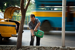 Taxi Driver (Satyaki Basu) Tags: street people india canon eos taxi indian 1750 driver tamron kolkata bengal calcutta westbengal 450d gettyimagesmiddleeast
