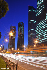 Cuatro Torres [Explored] (JdJ Photography (Aardewerk)) Tags: madrid road city sky cars tarmac night buildings dark way evening downtown traffic streetlights centre towers ciudad headlights bluehour autos innercity avond lucht publictransport asphalt centrum torens citycentre stad offices weg donker brakelights castilla asfalt openbaarvervoer gebouwen comunidaddemadrid verkeer koplampen bussen paseodelacastellana kantoren binnenstad chamartn lantaarnpalen remlichten straatverlichting businessarea autonomouscommunity communityofmadrid comunidadautnoma blauweuur zakengebied
