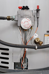 Home maintenance (Carroll Plumbing And Maintenance Inc) Tags: waterheater pipes gaspipe waterpipe faucet metal knobs controls appliance majorhouseholdappliance switch wires tank indoors nobody vertical
