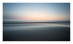 Simple Little Things (A-D-Jones) Tags: blue sea orange blur beach yellow liverpool landscape sand long exposure pan sweep crosby merseyside sefton hightown blundellsands