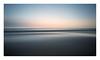 Simple Little Things (A-D-Jones) Tags: blue sea orange blur beach yellow liverpool landscape sand long exposure pan sweep crosby merseyside sefton hightown blundellsands