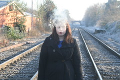 Smoke (na-da-ya) Tags: girl train cigarette smoke coat tracks