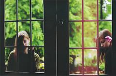 the hard way [explored!] (Mary Jo.) Tags: windows red flower green texture window rain canon rebel 50mm quiet mj double lightleak rainy manual xs f18 maryjo thehardway