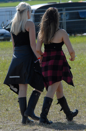 A sunny festival with many rubber boots to people