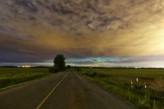 Aurora under the clouds (John Andersen (JPAndersen images)) Tags: sky night clouds highway alberta aurora springbank