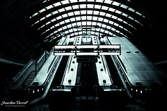 Canary Wharf Station (Jonathan.Russell) Tags: light white black building london window glass station architecture stairs canon mood russell jonathan expression escalator tube wharf canary tfl 40d promoteu jonooter