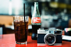 35 SP & MEXICAN COKE (La Branaro) Tags: camera stilllife food slr film austin table restaurant 1 texas drink kodak gear coke olympus 35mmfilm vintagecamera cocaco