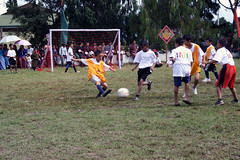 "Boys play a little pickup football game • <a style=""font-size:0.8em;"" href=""http://www.flickr.com/photos/76929546@N08/6893080351/"" target=""_blank"">View on Flickr</a>"