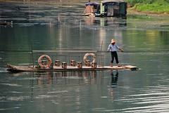 DSC_0090 Guilin, traghetto a mano sul fiume Li (tango-) Tags: china reflection reflections guilin riflessi kina cina picnik riflesso waterreflections çin wetreflections ประเทศจีน tiberiofrascari سين中國中国китайchinachinekinaquốc