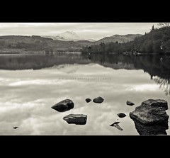 Ben Lomond from Loch Ard {Explore} (Wan ~stuck in catch up loop) Tags: longexposure trees water reflections landscape scotland rocks benlomond aftersunset snowcappedmountain lochard nikkor18105mm nikond7000 wmekwiphotography mekwicom