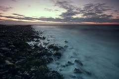 klagshamn (Andreas Hagman) Tags: longexposure sunset red sea sky orange seascape seaweed water clouds pier skne rocks waves sweden stones jetty horizon tripod gray shoreline windy le scandinavia groyne breakwater windturbines uwa sigma1020mm ndfilter gnd klagshamn neutraldensity stabil silkywater graduatedneutraldensity fotosondag sonyalphaslta77 ginordicfeb12 fs120226