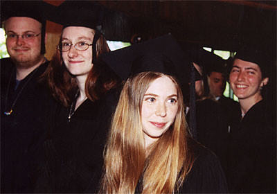 Graduates (from left to right) Link Hughes, Kristine Lemay, Jess Merrill and Rebecca Schein Exit Persons Auditorium.
