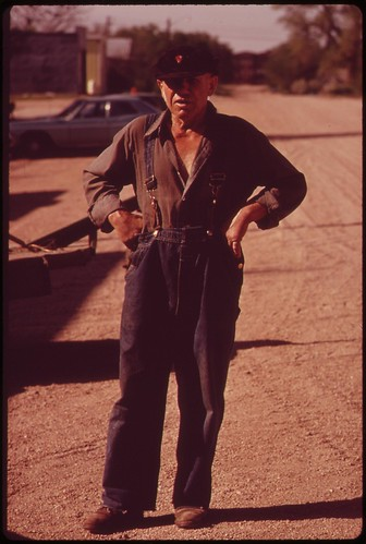 Charlie Gross, man of many trades, faces the camera on Grafton's main street, May 1973