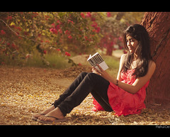 Stop this Train (Rahul De) Tags: autumn summer leaves lady reading back ic spring pretty young peach falling bits bougainvilea pilani fd2 nikond90 thedhammapada rahulde